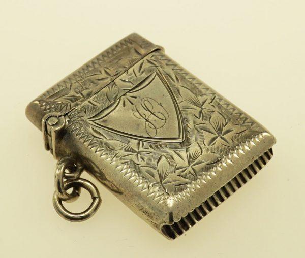 Tarnished sterling silver match box.